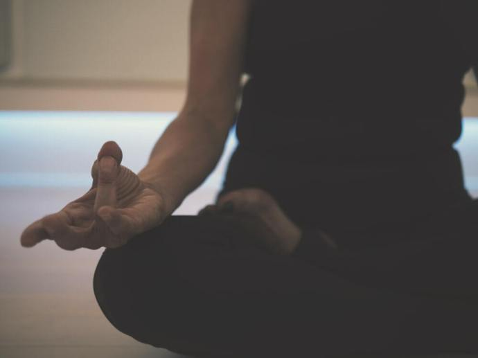 person doing yoga on floor