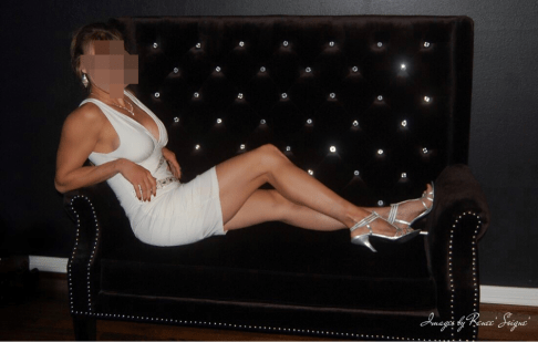 white dress black couch lounging blur.jpg