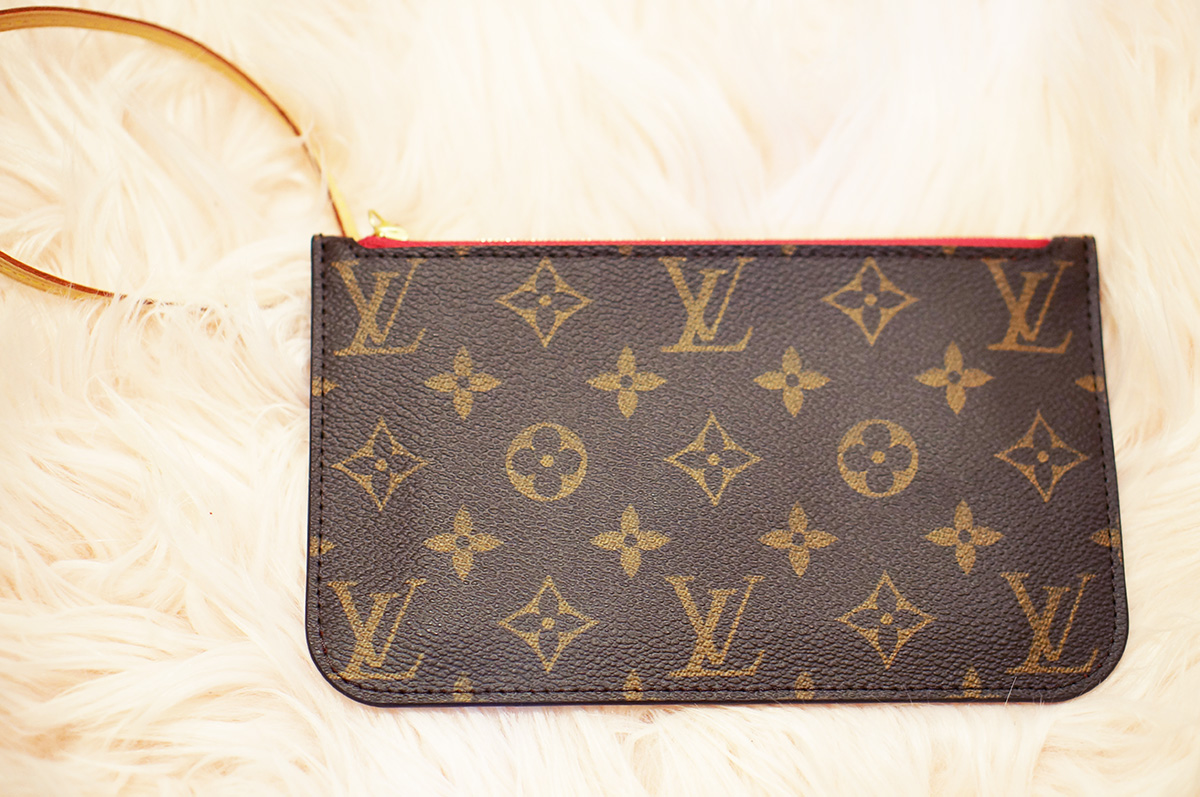 97d9ca4cfca4  325.00. Louis Vuitton small PM pouch pochette in monogram with Pivoine  interior. Also includes vachetta strap.