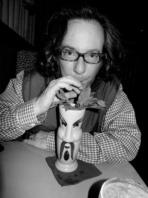 warren bobrow sipping a tropical cocktail