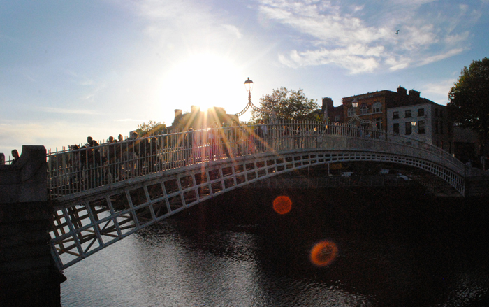 Crossing the Ha'Penny Bridge in Dublin, Ireland