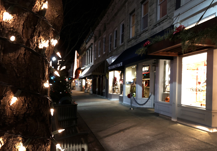 Festive downtown shops at night in Lake Geneva