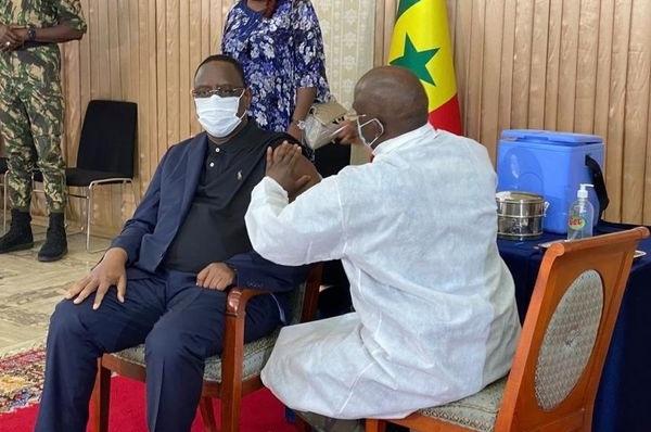 Senegal president takes coronavirus shot on live TV