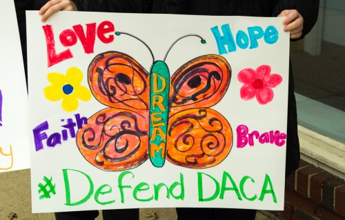 Colorful sign Defend DACA