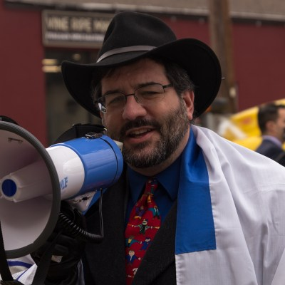 DACA rally members with megaphone
