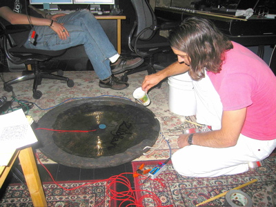 Brian Reitzel in the studio experimenting with gongs and water