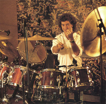 Drummer Simon Phillips with a tapestry