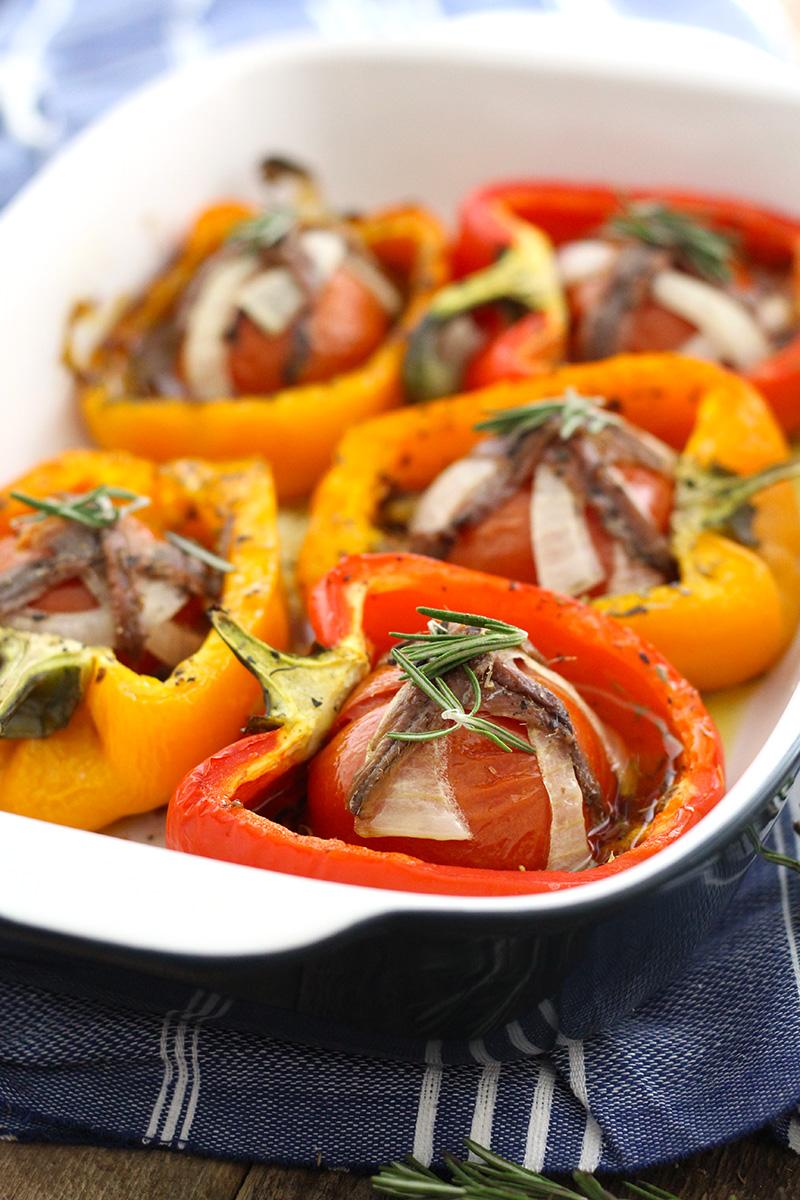 Tomato Garlic Stuffed Peppers are mouthwatering and packed with tomato, garlic, onion and lots of herbs and topped with anchovies!