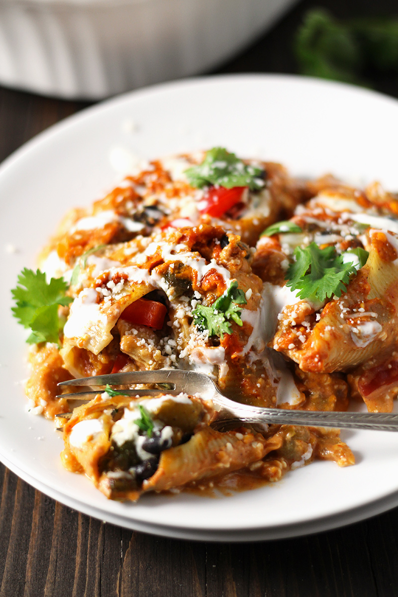 Cheesy Tex-Mex Chicken Stuffed Shells - Jumbo pasta shells packed with tex-mex style chicken and beans, and all smothered in a creamy, southwest cheese sauce.