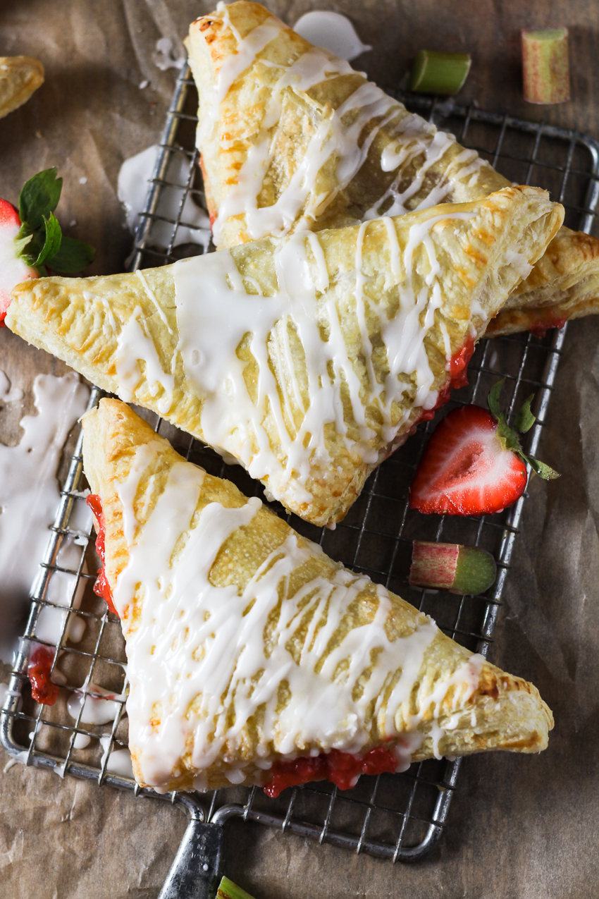 three strawberry rhubarb turnovers