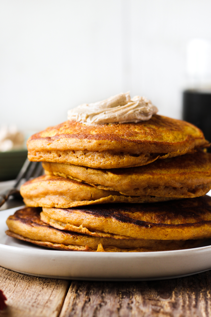 Fluffy pumpkin pancakes with cinnamon honey butter