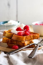 Cinnamon french toast with sugared raspberries and whipped lemon cream