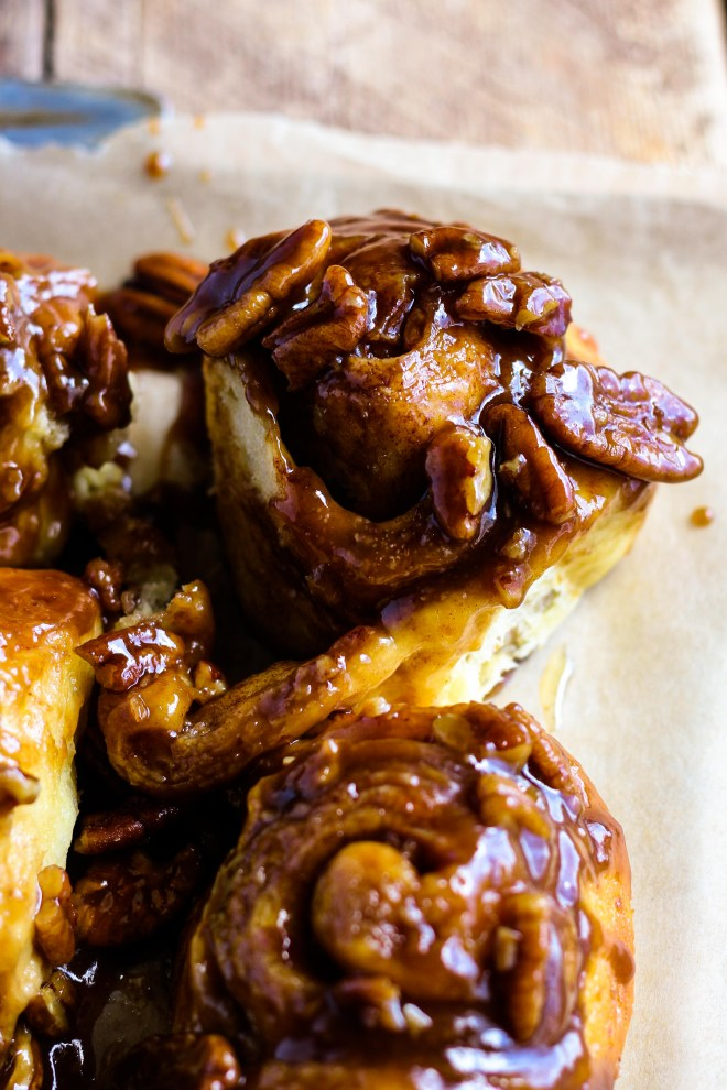 The MOST fluffy, soft, and delicious Caramel Pecan Sticky Buns! Homemade dough sprinkled with cinnamon sugar and baked in gooey caramel pecan sauce. This recipe includes the option to make them overnight so they're warm and fresh for breakfast.