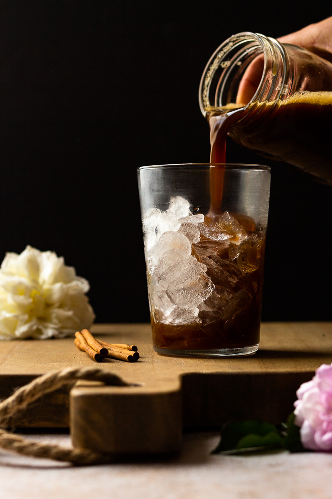 pouring shaken brown sugar syrup and espresso over ice