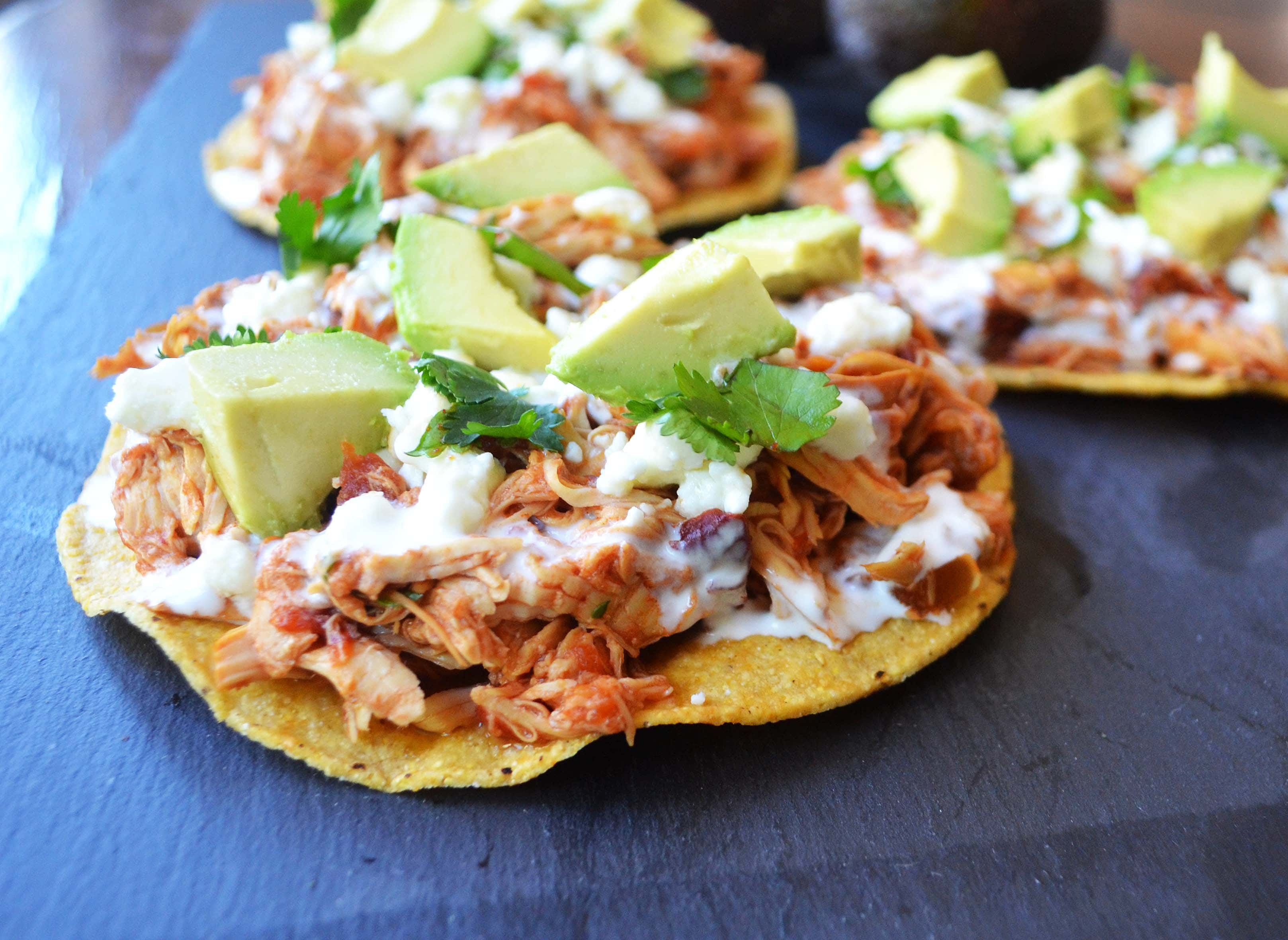 Slow Cooker Chicken Tinga Tostadas. 3 Ingredient Salsa chicken is the easiest dinner recipe and it tastes so good by Modern Honey - www.modernhoney.com