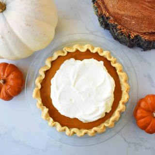 Perfect Pumpkin Pie by Modern Honey. Pumpkin Pie filling made with sweetened condensed milk, eggs, and spices. Creamy Pumpkin Pie every time!