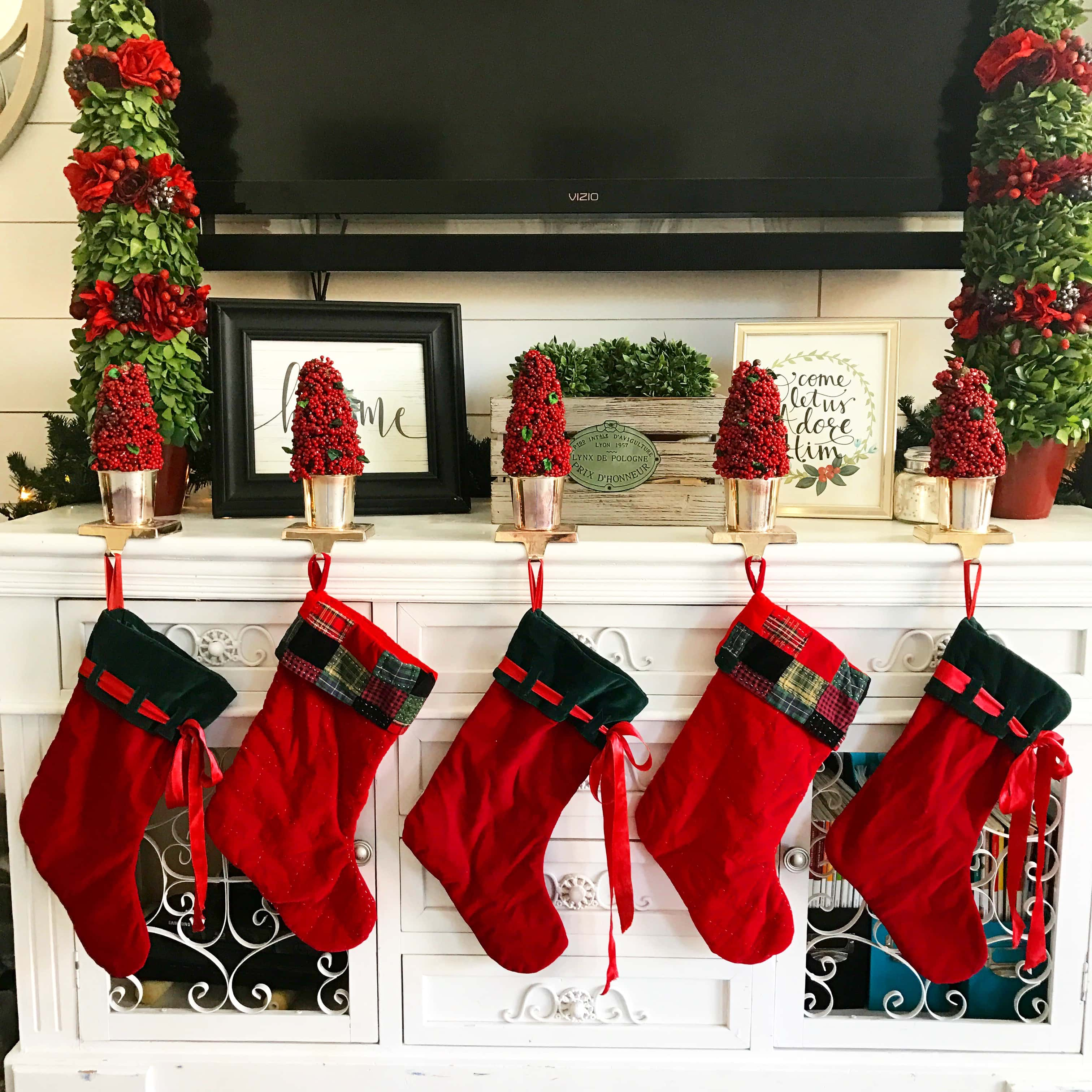 Christmas Decor Ideas by Modern Honey. Stockings display in family room.