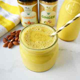 Ancient Golden Milk or Tumeric Tea Recipe. A healing tea full of anti-inflammatory and antioxidant benefits. Simmered with almond milk, tumeric, ginger, cinnamon and a touch of maple syrup. Warm and comforting tumeric tea. www.modernhoney.com