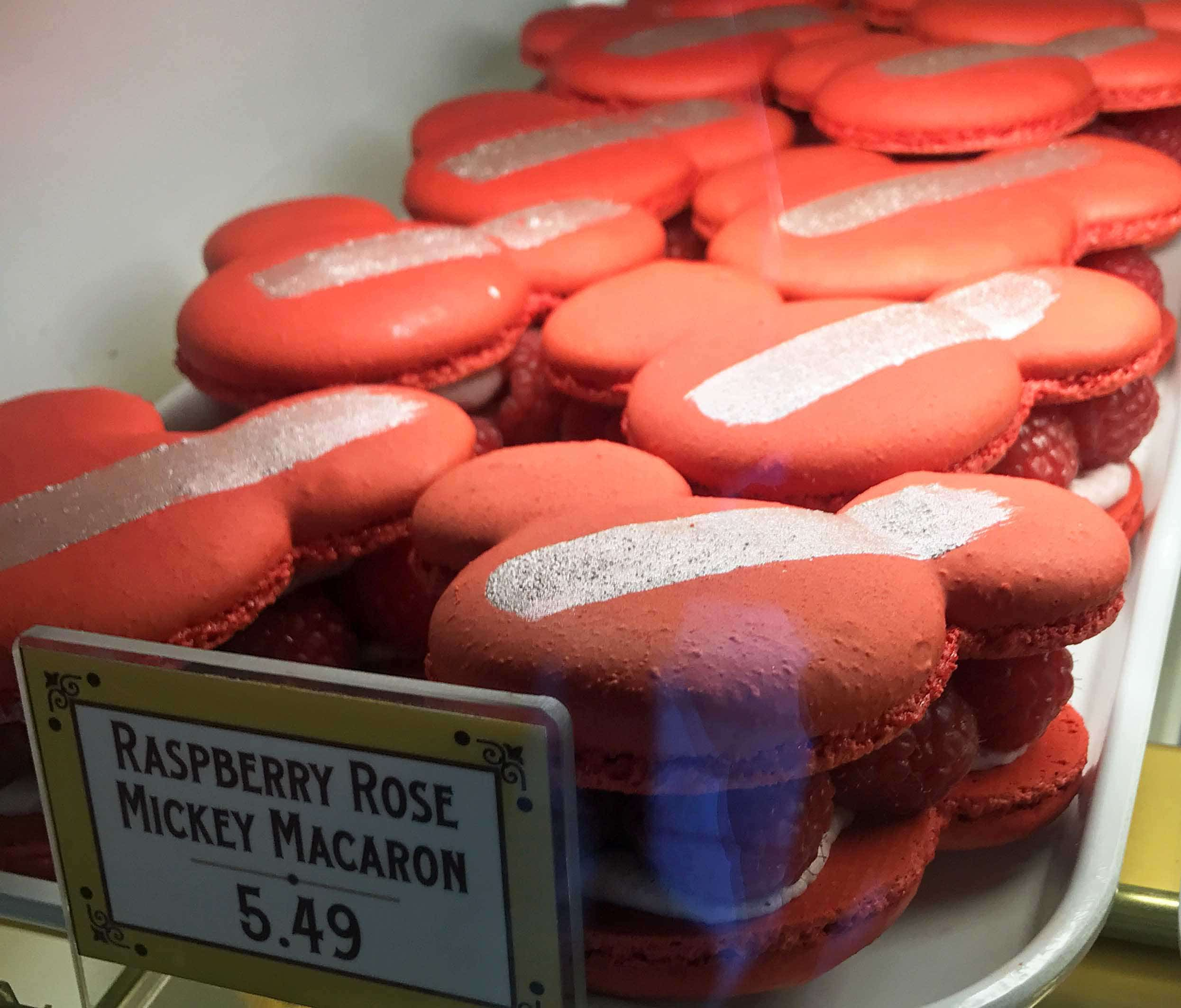 Raspberry Rose Mickey Macaron. The Best Eats and Treats at Disneyland. The best food to eat at Disneyland. A list of the most popular and favorite food at Disneyland parks. A list of what to eat at Disneyland. www.modernhoney.com