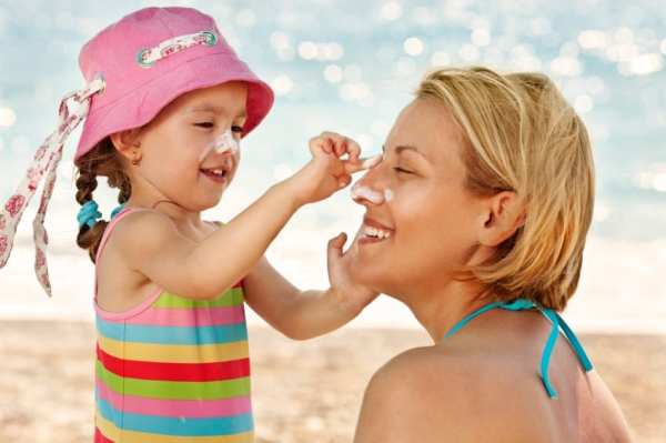 Image result for children and mom putting on sunscreen