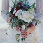 Rustic wedding dress with bouquet of flowers in front