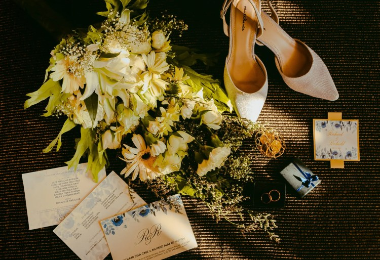 Rustic wedding invitations with flowers and white shoes