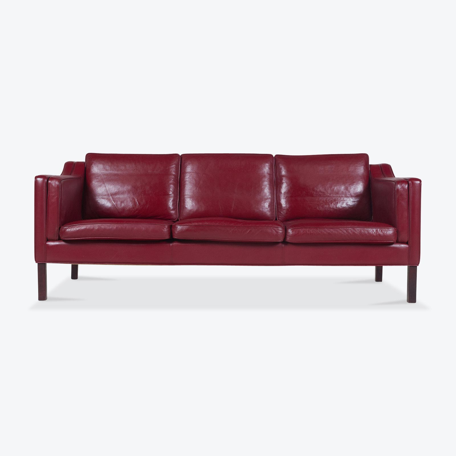 cherry red leather sofa one seat with chaise 3 in and stained legs 1960s