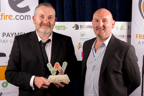 Eamon Donovan and David Henry with the trophy for An Suíomh Gaeilge is Fearr (Best Irish Language website) won by Conradh na Gaeilge (cnag.ie) at the 2014 Realex Fire Irish Web Awards at the Ballsbridge Hotel in Dublin.
