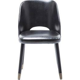 Stuhl: Rock´n Roll Attitude Stylischer Polsterstuhl mit Rock´n Roll Attitude. Coole Akzente durch Messing-Kappen an den Beinen. Bezug in schwarzer Lederoptik. Rückseite in Kontrastfarbe bezogen. Frei im Raum aufstellbar. Auch als Sitzbank erhältlich.