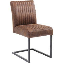 Stuhl: Modern Retro Dieser lässig gestylter Freischwinger besticht mit seiner coolen Retro-Note der durch die bewusste reduzierte Gestaltung dennoch sehr modern wirkt. Seinen besonderen Reiz erhält dieser Stuhl durch den abgesteppten Sitz und Rücklehne. Dieser Polsterstuhl ist auch in der Farbe Grau und als Version mit Armlehne erhältlich.