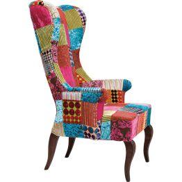 Sessel: Patchwork deluxe in unwiderstehlicher Kombination Dieser feine Patchwork-Sessel könnte einem Tim Burton Film entsprungen sein. Die extra hohe Rückenlehne verleiht dem Sessel einen imposanten Look. In Kombination mit den erhabenen hochwertigen Relief Ausbrennerstoffen