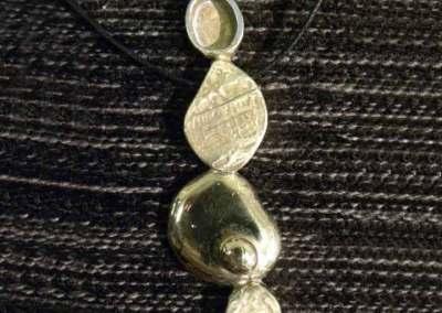 CIONDOLO PIENI E VUOTI (argento 2)