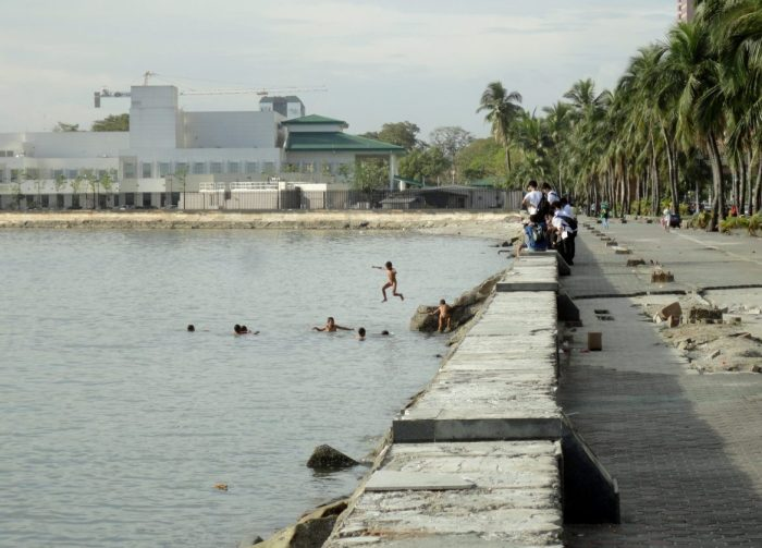 Boys swimming in filthy Manila Bay