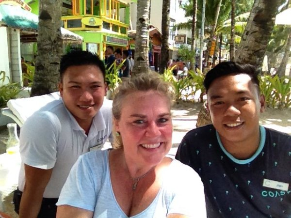 Broke down and bought a selfie stick. Jony and Jawo from Coast Hotel show me how to use it