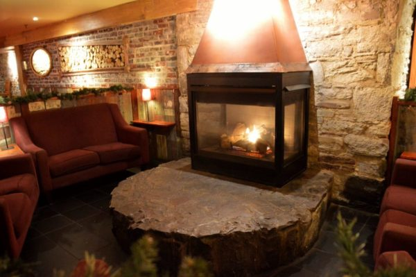 Inviting fireplace at C'Est What Restaurant in Toronto