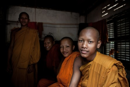 Young monks chilling out in their room while waiting for the ceremony.
