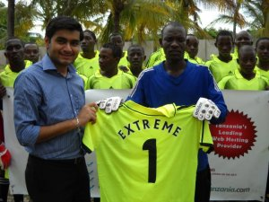 "Mohsin handing T-Shirt of ""Extreme #1"" to Goalkeeper"