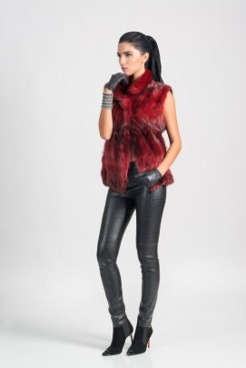 Red sable vest (dyed color), Malimo; jeans, bracelet, all - Marc Cain; booties, Baldinini; gloves, stylist's own.