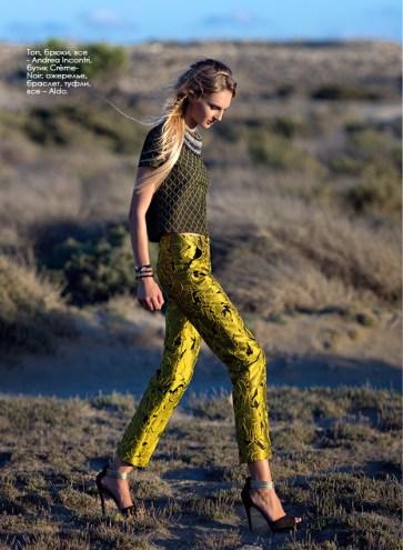 Top, trousers, all - Andrea Incontri, Crème-Noir boutique; necklace, bracelet, shoes, all – Aldo.