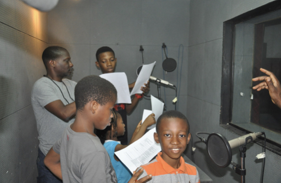 VOICE OF TURTLE TAIDO, SAMUEL ADESEKO (smiling), with other members of the cast.