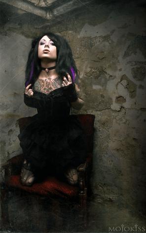 gothy girl in a corner