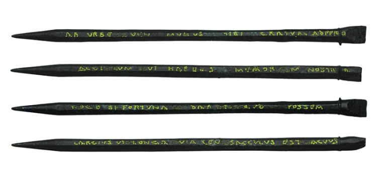 A unique inscribed Roman stylus uncovered by MOLA archaeologists during excavations for Bloomberg's European headquarters in London. The inscription has been highlighted in yellow (c) MOLA