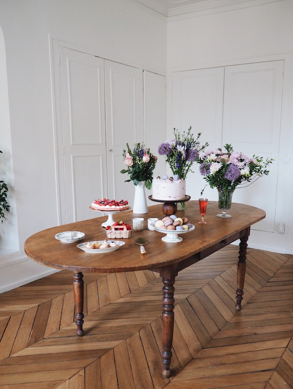 Antique French Farm table covered with pastries from a pastry workshop in Versailles
