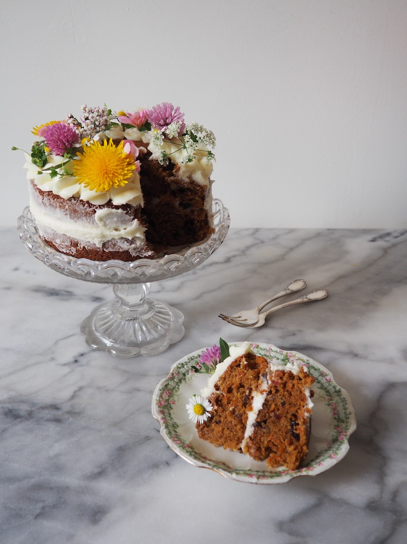 Carrot cake with cranberries and pecans and a fresh goat cheese frosting