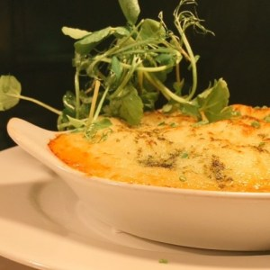 Seafood pie in a white oval dish