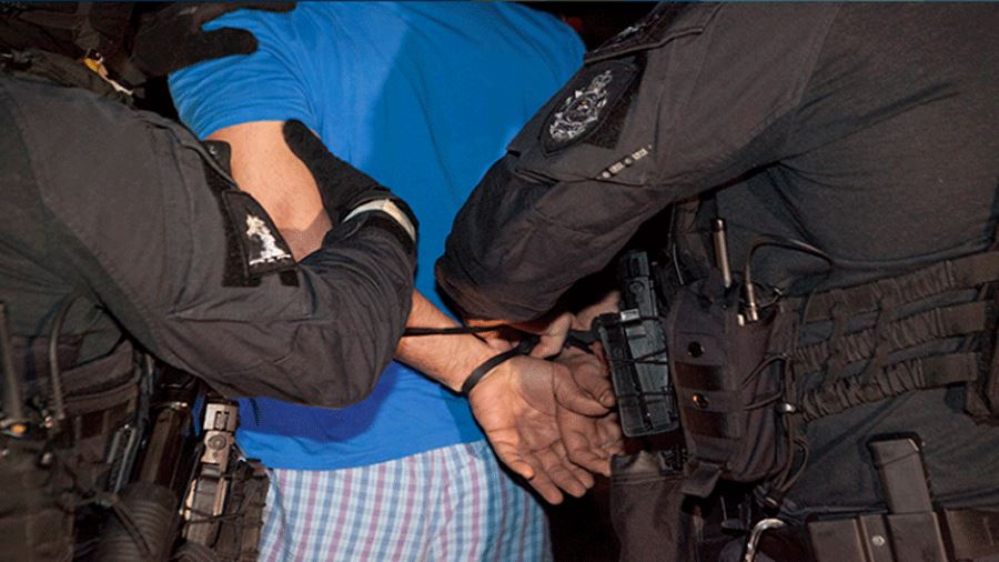 arrestee in handcuffs