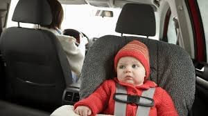 baby in carseat during winter