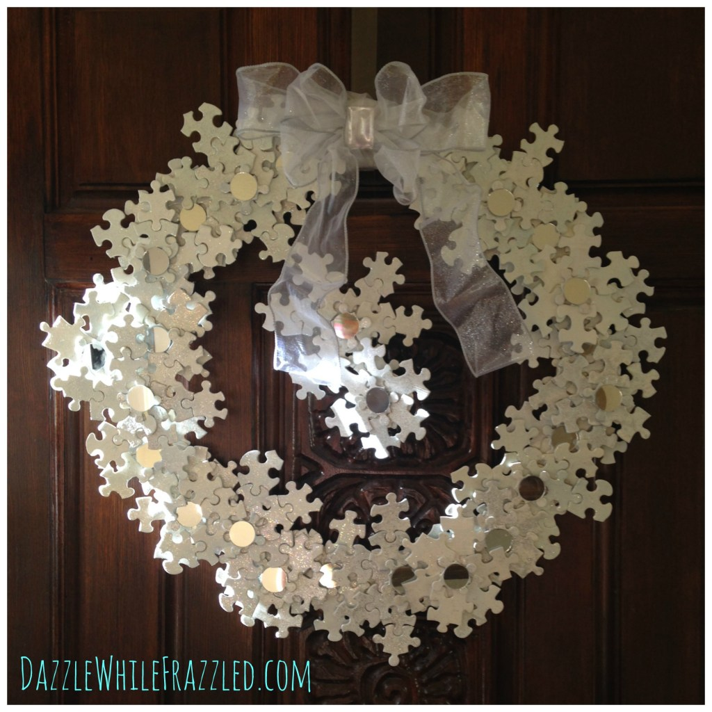 12+ of my favorite Christmas wreath tutorials, including this Puzzle Pieces Snowflake Wreath! Learn how to make wreaths to decorate your home, everywhere from your front door to your kitchen! The wreaths use everything from fresh evergreens to these puzzle pieces (a genius way to save money when you make your wreath. You gotta see it!) and everything in between. Check it out to get some fabulous ideas.