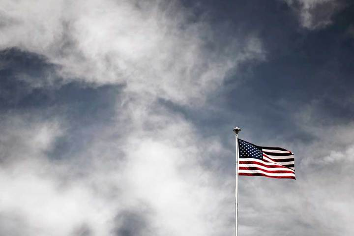 U.S. Flag in Cloudy Sky