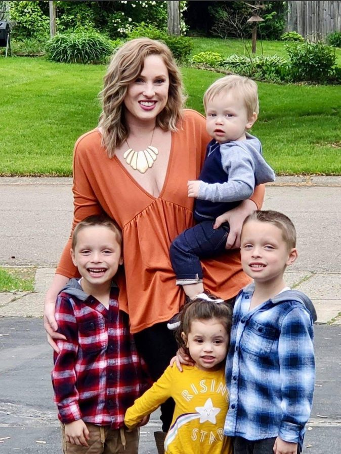 Ashley standing with her family of four children, including the one child she never knew she wanted